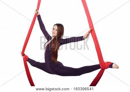 Woman girl practicing aerial air yoga acrobatics in studio isolated white background silk gymnast tissue acrobat