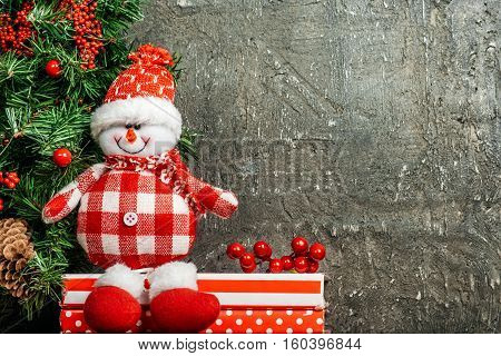 Christmas, toy snowman on gray background. Place for text.