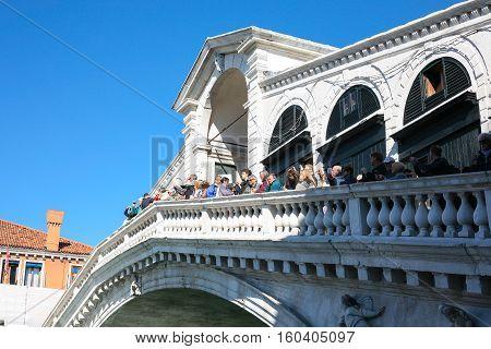 Tourists On Rialto Bridge In Venice
