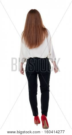 walking red head business woman. back view. going young girl in  suit. Rear view people collection.  back side view of person.  Isolated over white background.