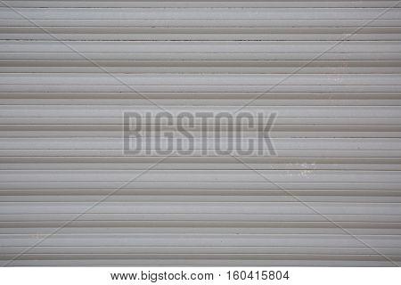 a grey metallic garage door for backgrounds