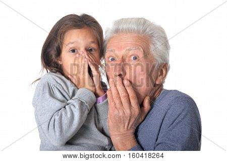 Portrait of surprised grandfather and granddaughter isolated on white background