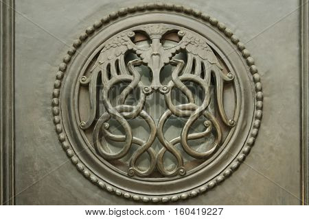 London UK - July 28 2007: interlocking serpents forming decorative grill on door Bank of England Threadneedle St London The Bank of England is the central bank of the UK