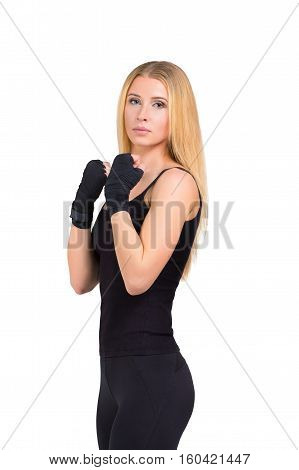 Fitness sporty woman studio shot - blonde girl stands in black sportswear, isolated at white background. Fitness strong girl.
