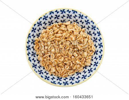 Puffed wheat in the bowl isolated on the white background