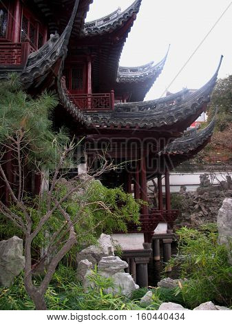 photo from architectural buildings of ancient Chinese culture in the ancient Park the Yuyuan garden of Joy in Shanghai (China)