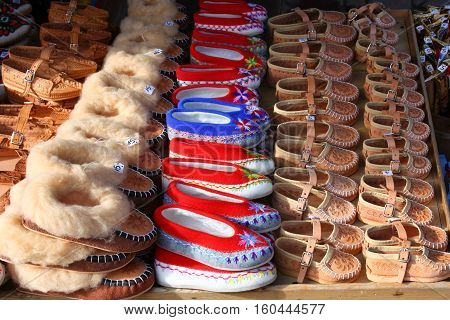 Traditional polish leather mountain boots for children called 'kierpce' on outdoor market