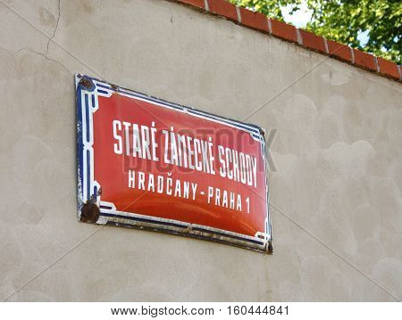 Street sign of Old Royal Castle stairs in Prague beautiful european city. Czech Republic