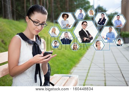 Social Network Concept - Portrait Of Beautiful School Girl Or Student Sitting On Bench With Phone In