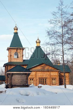 wooden tserkovv Russia in winter sunny day
