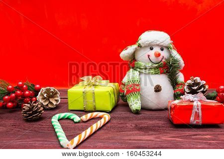 The photograph depicts Christmas background with toys