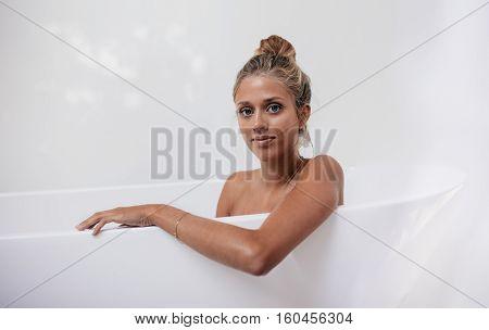 Young Female Sitting In Bathtub