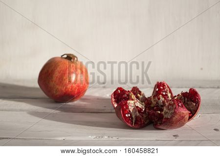 Pomegranate on a white background ripe pomegranate red pomegranate on a white background pomegranate seeds