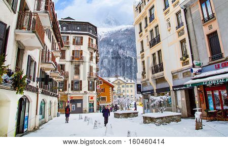 Chamonix, France - January 30, 2015: Street view, Cafe, nice houses, people walking in the center of Chamonix town in French Alps, France