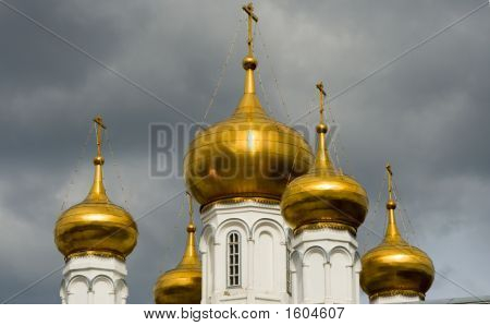 Christian Temple With Domes On A Background Of Clouds