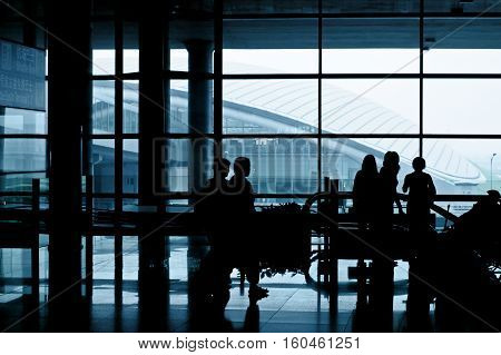 Modern airport interior with people. Toned image.