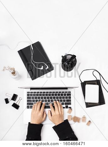 Female hands typing on a laptop keyboard. Shopper doing online shopping. Miniature of shopping and reusable grocery bags on the table. Flat lay view.