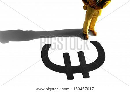 Business man figurine standing in front of a Euro symbol