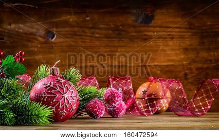 Christmas Time.Christmas candle and decoration. Christmas border design on the wooden background. Christmas fir tree with christmas candle and decoration.