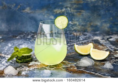 Sparkling cucumber mint gin and tonic fizz with aloe vera on marble table. Copy space