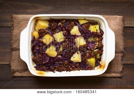 Baked red cabbage apple mincemeat and potato casserole in dish photographed overhead with natural light (Selective Focus Focus on the top of the dish)