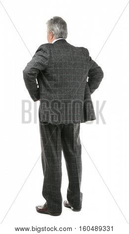 Senior businessman standing back on white background