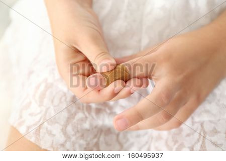 Close up view of little girl's finger with applied sticking plaster