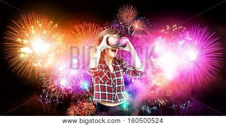 Double exposure, girl getting experience using VR glasses, being in virtual reality, watching fireworks, New Year