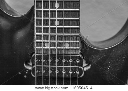 Close up of a seven string guitar
