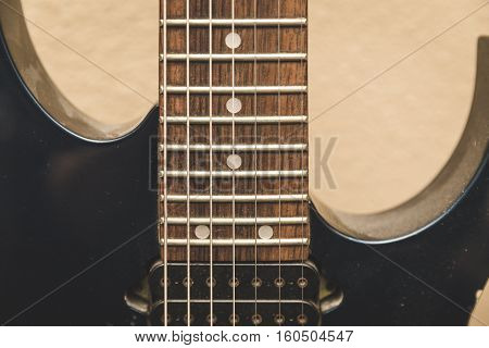 Seven string guitar close up on strings