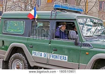 TIMISOARA ROMANIA - DECEMBER 1 2016: Military parade at Romanian National Day. Woman cop give one official salute. Picture taken in front of the Administrative Palace in Timisoara.