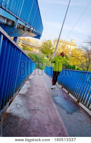 Young woman doing sport at autumn sunset in Alcala de Henares Madrid Spain