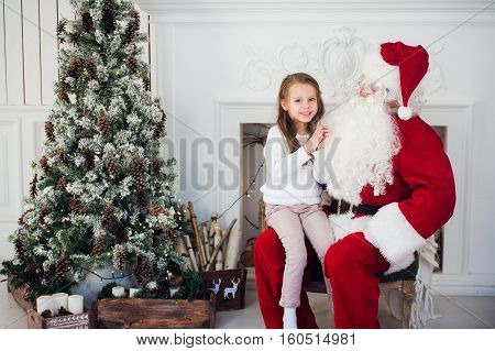 Santa Claus and child at home. Christmas gift. Family holiday concept.