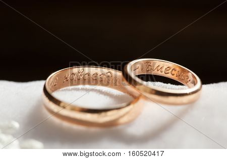 The composition of the wedding rings closeup lying on a cushion