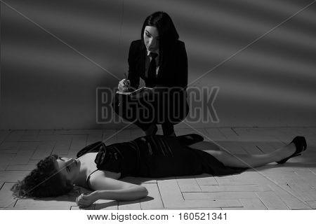 Detective Woman Investigating The Crime Scene