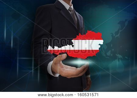 Businessman showing map of Austria on globe background