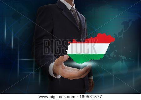 Businessman showing map of Hungary on globe background