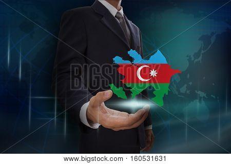 Businessman showing map of Azerbaijan on globe background