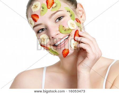 Smiling Cheerful Woman With Fruit Facial Mask On Face