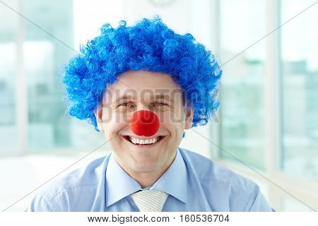 Portrait of a manager in clown wig and nose