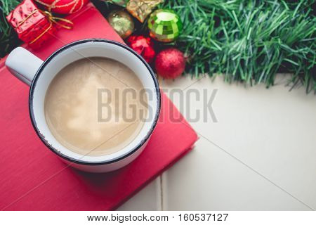 Christmas tree in Coffee Cup with Balls and gift Boxes on the Book and Blank Space Vintage Tone