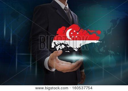 Businessman showing map of Singapore on globe background