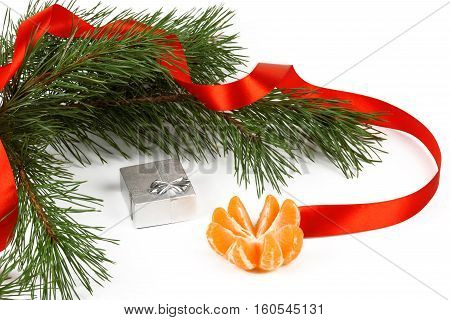 Tangerine silver box and green pine branches on a white background.