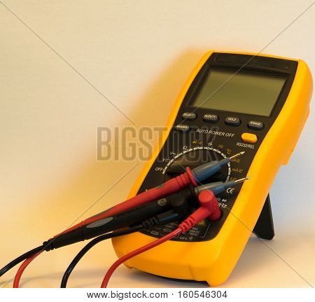 Digital multimeter with test leads connected - isolated