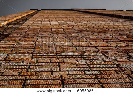 Brickwork. Grunge brick wall. Rough brick wall. Grunge brick background. Wall of large brick building