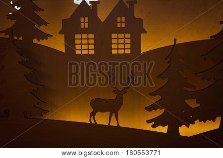 Beautiful Christmas interior. New year decoration. Deer in the forest and houses