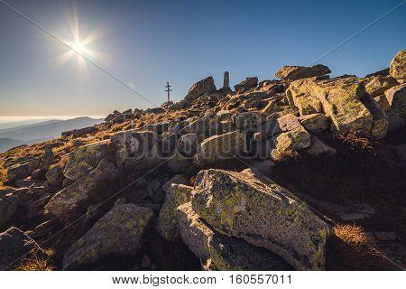 Sun over Mountain Peak with Double Cross. Mount Dumbier Low Tatras Slovakia
