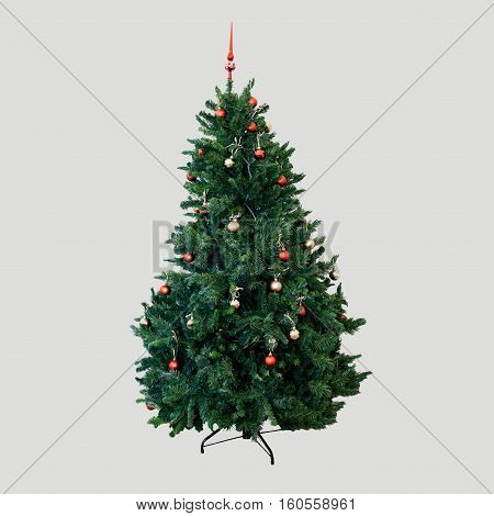 New year fir tree decorated with toys and balloons. Green fluffy Christmas beauty natural fir tree. Coniferous symbol of Christmas. Tree isolated on background.
