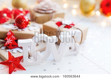 Christmas New Year or Valentine's Day background with presents and decorations. Holiday background with stars confetti and light bulbs. Place for text.