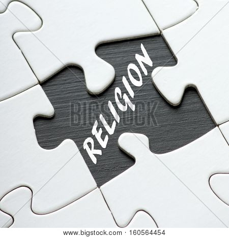 The word Religion revealed by a missing jigsaw puzzle piece